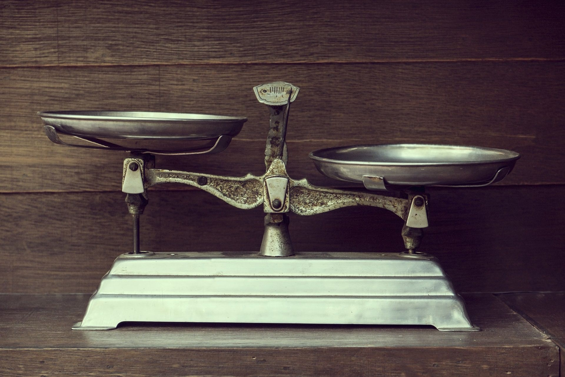 Vintage balance on wood background